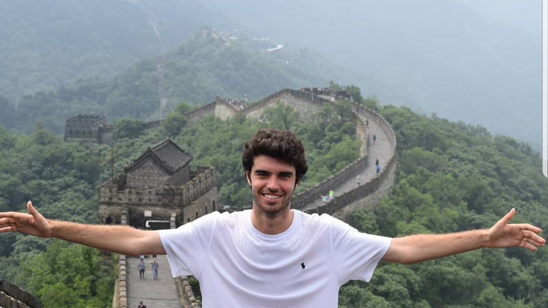 Yago Carrera a technology expert next to Great Wall of China