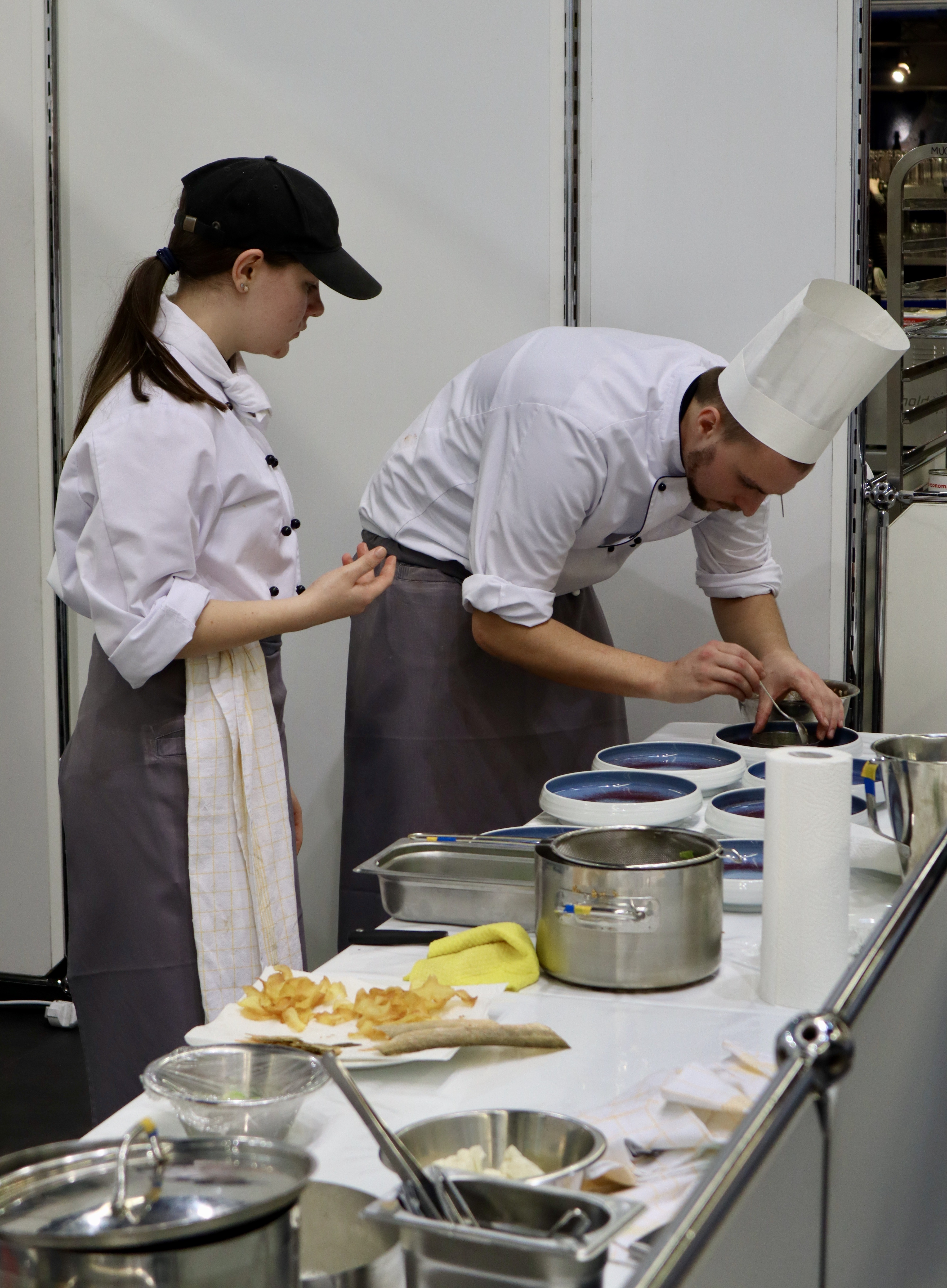 Cooks preparing their dish for the competition