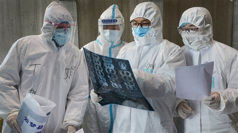 Picture of medical personnel observing medical covid-19 results